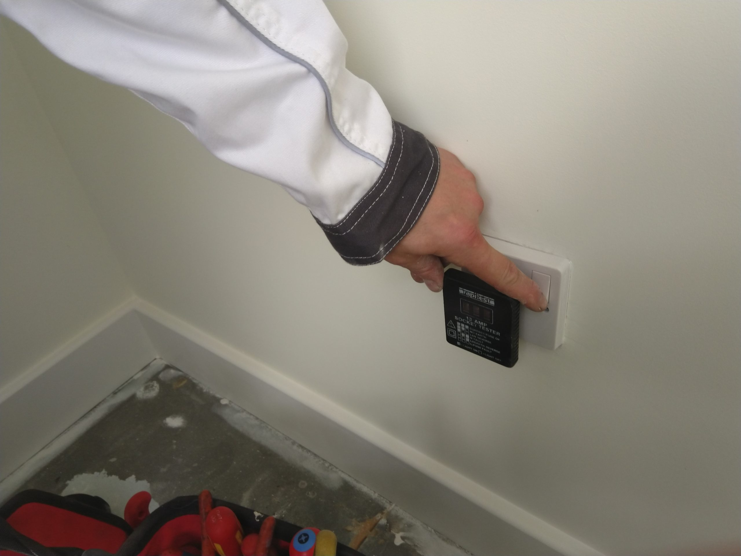 Electrician checking polarity of 13 Amp Socket on a new build in Suffolk